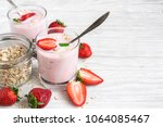 two glasses of healthy... | Shutterstock . vector #1064085467