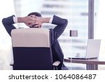 businessman relaxes sitting in... | Shutterstock . vector #1064086487
