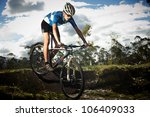 Young man riding a bike - stock photo