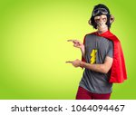 superhero monkey man pointing... | Shutterstock . vector #1064094467