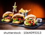 tasty cheeseburgers with french ... | Shutterstock . vector #1064095313