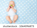 baby boy with teether toy in... | Shutterstock . vector #1064096873