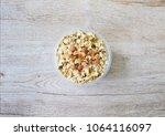 top view muesli with almonds ... | Shutterstock . vector #1064116097