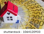 a lot of euro and house on the... | Shutterstock . vector #1064120933