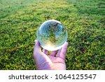 crystal ball display a fresh... | Shutterstock . vector #1064125547