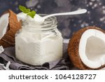 coconut yogurt in a glass jar... | Shutterstock . vector #1064128727