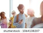 young traveler with smartphone...   Shutterstock . vector #1064138207
