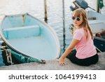 kid girl resting in small port... | Shutterstock . vector #1064199413