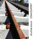 railroad tracks are old but... | Shutterstock . vector #1064204987