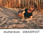funny kid boy resting on sand... | Shutterstock . vector #1064209157