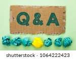 Small photo of Conceptual hand writing showing Q A. Business photo text Ask Frequently Faq Asked Question Help Solving Doubt Query Support written on Tear Cardboard on plain background Crumpled Paper Balls.