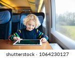 child traveling by train.... | Shutterstock . vector #1064230127