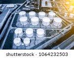 oil silos at petroleum refinery | Shutterstock . vector #1064232503