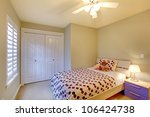 Kids bedroom with minimal design and beige walls. - stock photo