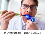 funny dentist with curing light ... | Shutterstock . vector #1064365127