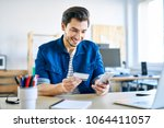 young creative worker using... | Shutterstock . vector #1064411057