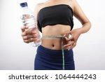 lose weight woman concept diet... | Shutterstock . vector #1064444243