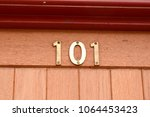 Small photo of House number 101 sign at top of door