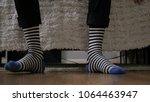 feet in socks on floor  waiting ... | Shutterstock . vector #1064463947