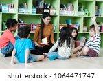 young asian woman teacher... | Shutterstock . vector #1064471747