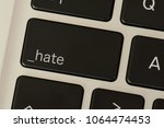Small photo of A computer and a hate button