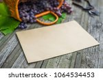 basket with grapes beside... | Shutterstock . vector #1064534453