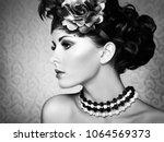 retro portrait of a beautiful... | Shutterstock . vector #1064569373