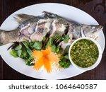 thai snake head fish steam... | Shutterstock . vector #1064640587
