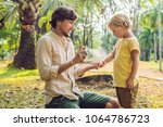 dad and son use mosquito spray...   Shutterstock . vector #1064786723