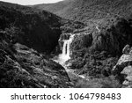 Small photo of Photos of a large waterfall in a forest with a river with excess water due to excessive rainfall and cold