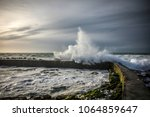 wave hitting the dombret basin... | Shutterstock . vector #1064859647