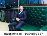 stylish man sits store costumes ... | Shutterstock . vector #1064891837