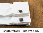cufflinks with shirt on the... | Shutterstock . vector #1064955137