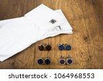 cufflinks with shirt on the... | Shutterstock . vector #1064968553