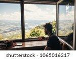 man traveler holding glass of... | Shutterstock . vector #1065016217