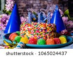 birthday cake with rainbow... | Shutterstock . vector #1065024437