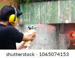shot gun magazine in hand of...   Shutterstock . vector #1065074153
