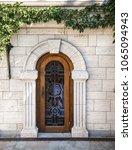 old wooden door in arched...   Shutterstock . vector #1065094943