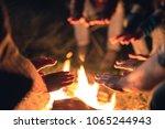 the people warming hands near... | Shutterstock . vector #1065244943
