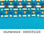 pills and capsules on a blue... | Shutterstock . vector #1065251123