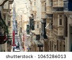 old narrow street with... | Shutterstock . vector #1065286013