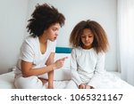 mother scolding her daughter ... | Shutterstock . vector #1065321167