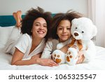 mother and daughter enjoying on ... | Shutterstock . vector #1065325547