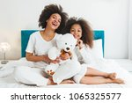 mother and daughter enjoying on ... | Shutterstock . vector #1065325577