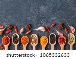 various indian spices in wooden ... | Shutterstock . vector #1065332633