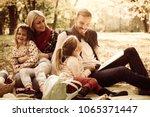happy family having picnic....   Shutterstock . vector #1065371447