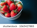 red fresh strawberry on black... | Shutterstock . vector #1065427883