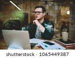 serious male student in eyewear ... | Shutterstock . vector #1065449387