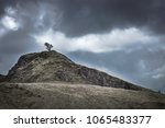 tree on top of the rocky hill... | Shutterstock . vector #1065483377