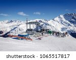 Small photo of ZINAL, SWITZERLAND – FEBRUAR 16, 2018: People on skies waiting in front of the new Grimentz - Zinal cable car. Skiing is getting more popular all the time.